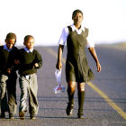 Children run to school in Kwa-Zulu Natal, South Africa